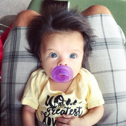Baby born with glamorous head full of hair is taking the internet by storm