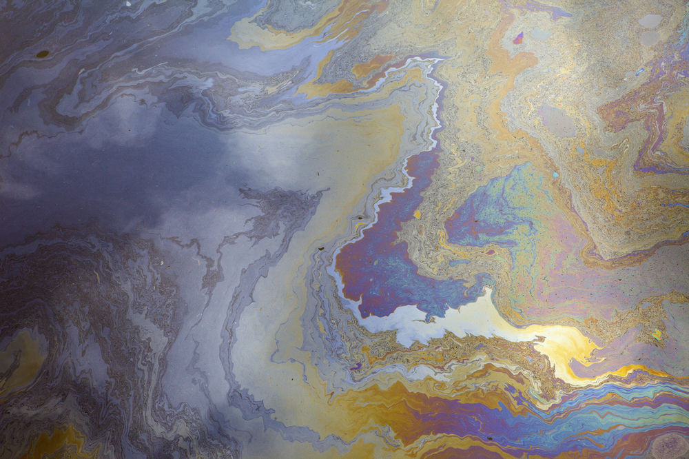 A mixture of hydrocarbon monomers, here represented depressingly by oil pollution in the sea. huyangshu-Shutterstock